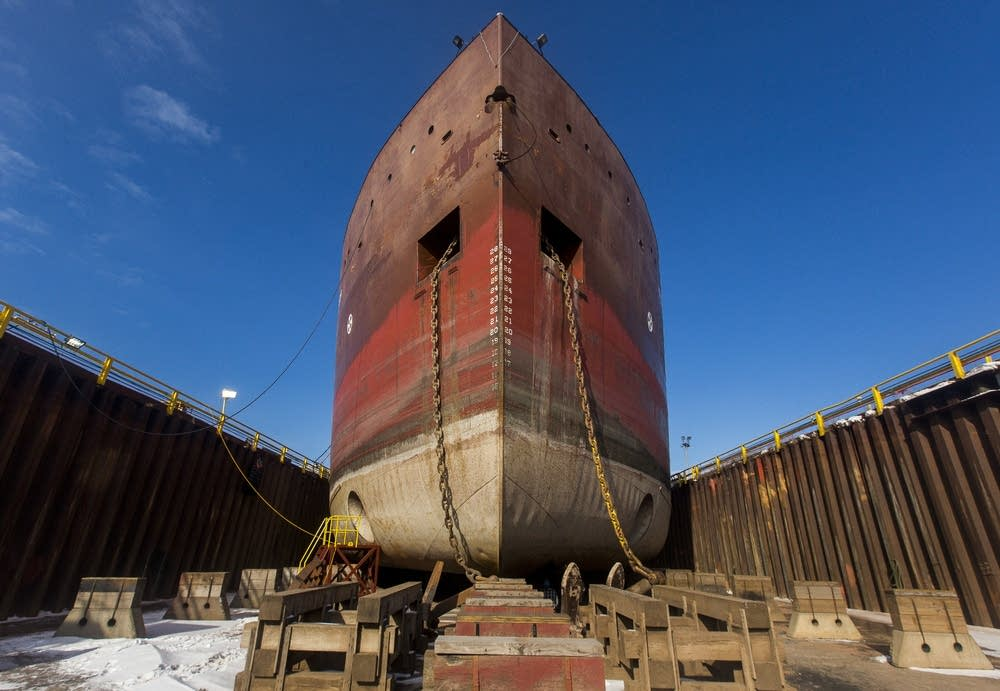 Red steel ship being constructed with ABS grade plates
